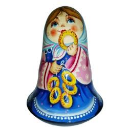 Неваляшка Девочка с баранками (высота 11 см., D7 см.)
